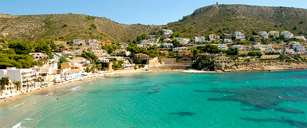 Abahana Villas - Playa de El Portet con torre de Cap d'Or.