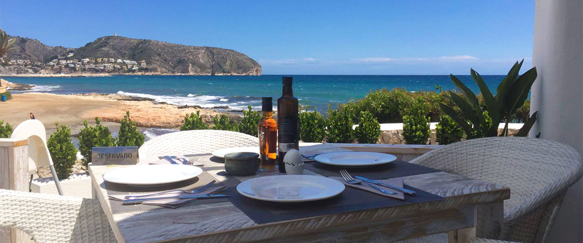 Abahana Villas - Beach of Les Platgetes from the restaurant El Chamizo in Moraira.